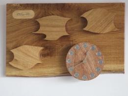 """SHOAL OF FISH"" a wall clock in oak and mahogany 26cm x 46cm (11 x 18inch)"