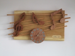 """""""BURST OF MUSIC"""" a wall clock in oak and mahogany with beech """"staves"""" 30cm x 48cm (12 x 19inch)"""