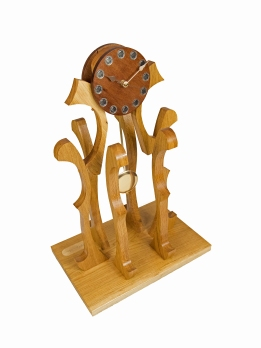 """""""CENTRE PIECE"""" a table clock 61cm (24inch) high with a pendulum clock movement and constructed in oak with a mahogony dial"""