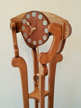 """""""GRAND DAUGHTER CLOCK"""" standing 114cm (45inch) high with a pendulum clock movement and oak construction with a mohogany dial"""