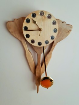 """""""WALL MOUNTED PENDULUM CLOCK"""" made of sycamore and in the style of 3 darts."""